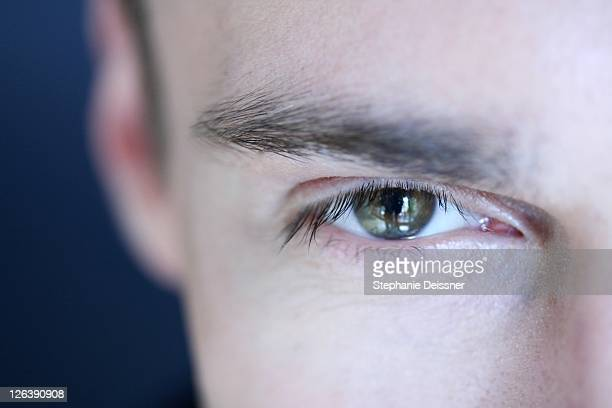 close-up of man's eye - 25 29 jahre stock pictures, royalty-free photos & images