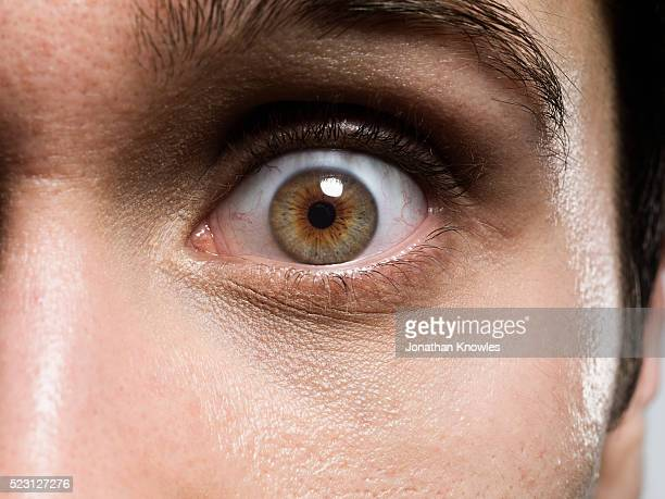 close-up of man's eye - extreme close up stock pictures, royalty-free photos & images