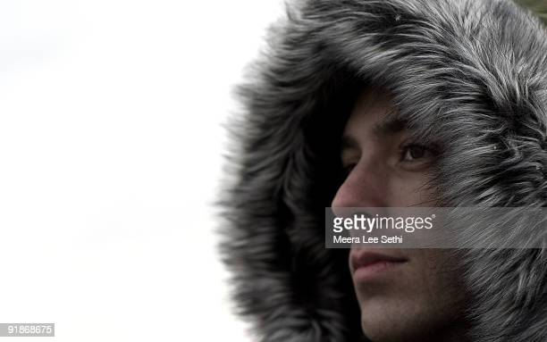 close-up of man's face in furry parka hood - parka coat stock photos and pictures