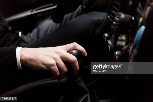 close-up of man's hand at gearshift in car - gearshift stock photos and pictures