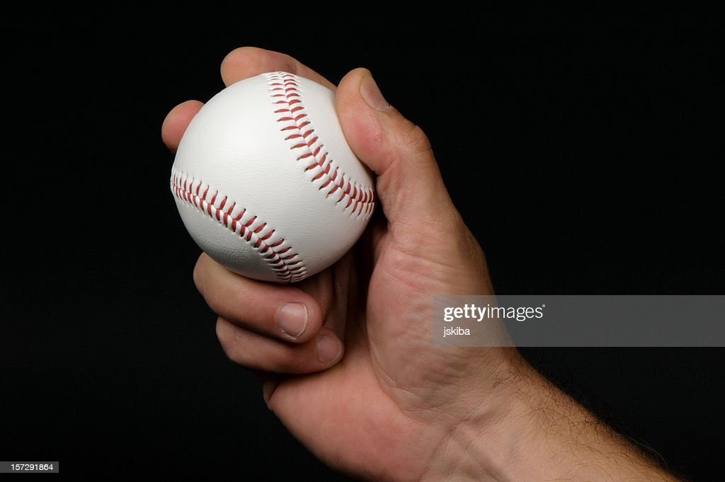 Close-up of man's hand griping a baseball : Stock Photo