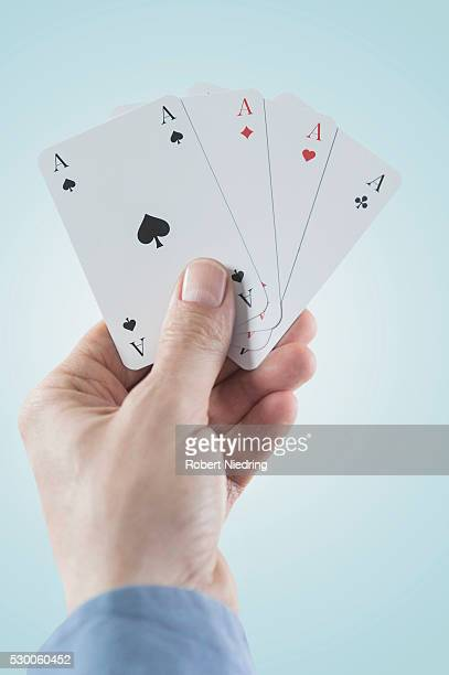 Close-up of man's hand holding four aces, Bavaria, Germany
