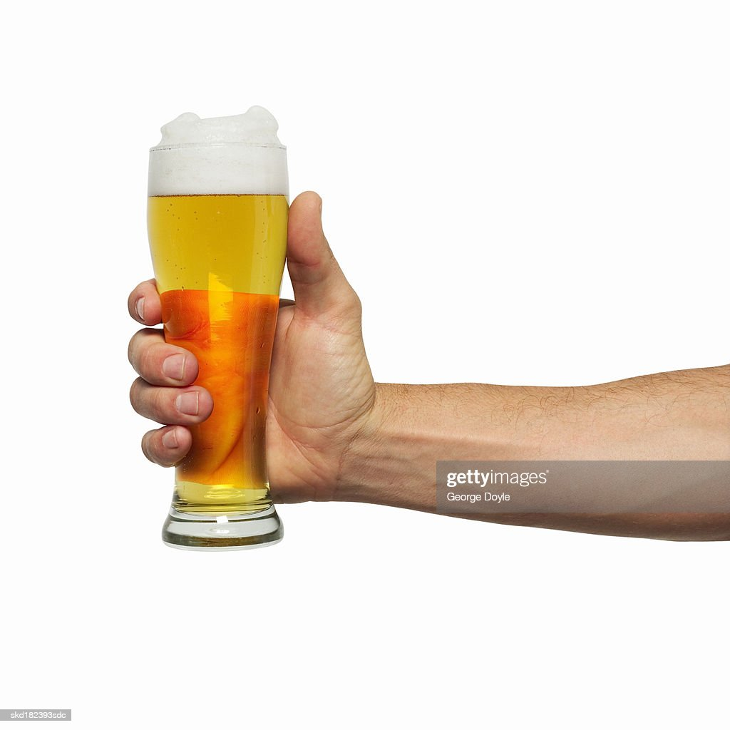 Close-up of man's hand holding glass of beer : Stock Photo