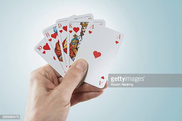 Close-up of man's hand holding playing cards, Bavaria, Germany