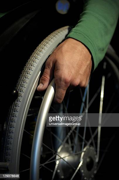 Close-up of man's hand on wheelchair