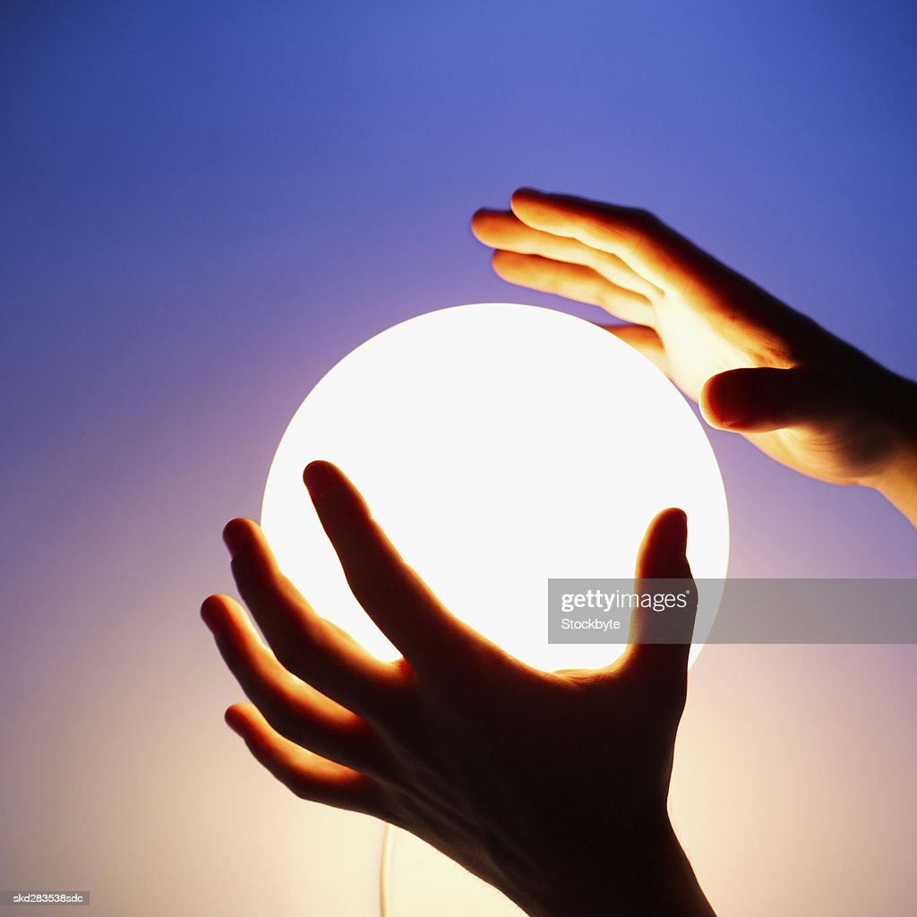 Close-up of man's hands touching crystal ball : Stock Photo
