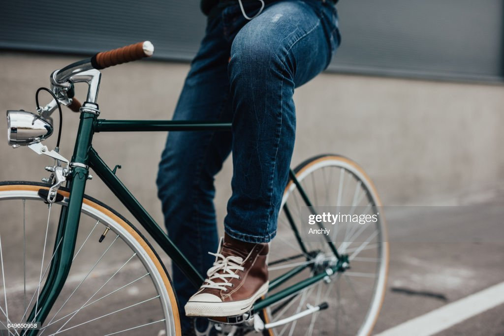 Close-up of man's legs of the bicycle pedal : Stock Photo