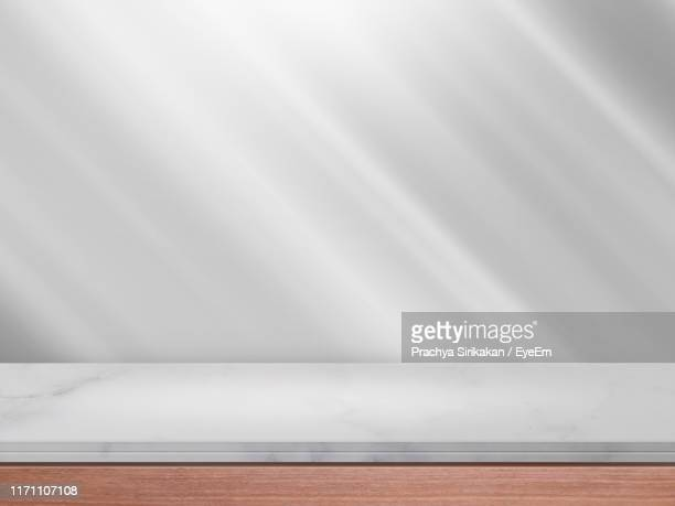 close-up of marble on table at home - tafel stockfoto's en -beelden