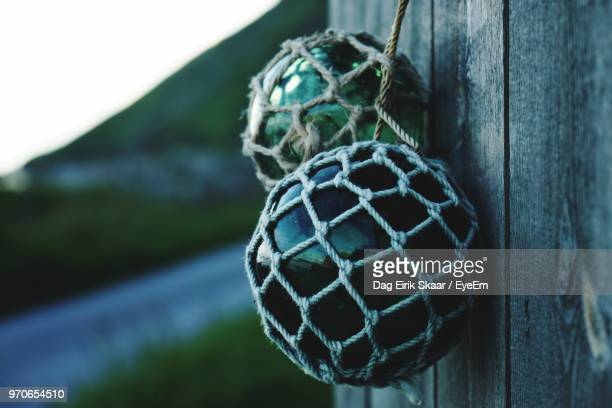 Close-Up Of Marbles In Net Hanging By Pole