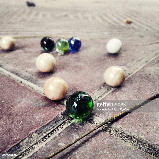 Close-Up Of Marbles On Floor