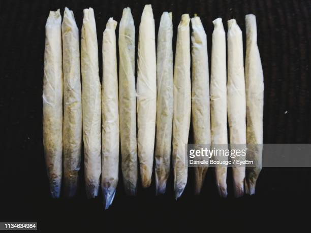 close-up of marijuana joints on black background - marijuana joint stock pictures, royalty-free photos & images