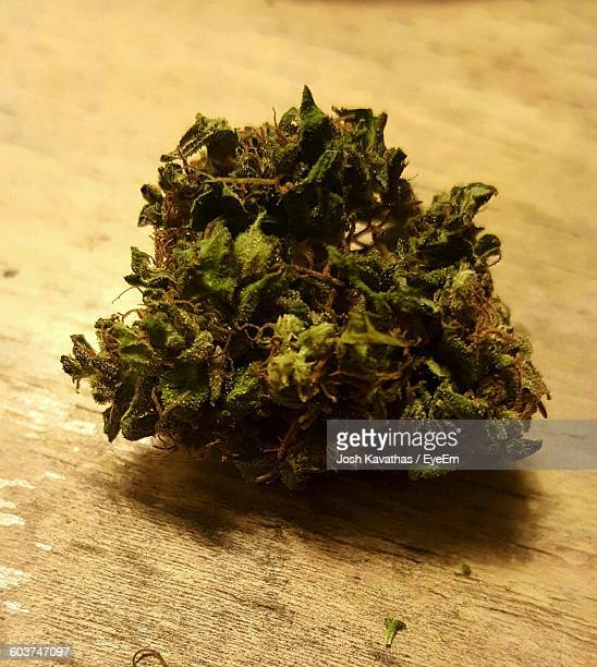 Close-Up Of Marijuana On Table
