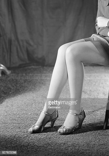 A closeup of Marjorie Roye's legs wearing high heels Ca 19451960