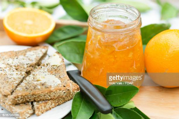 Close-up of marmalade with buttered toast