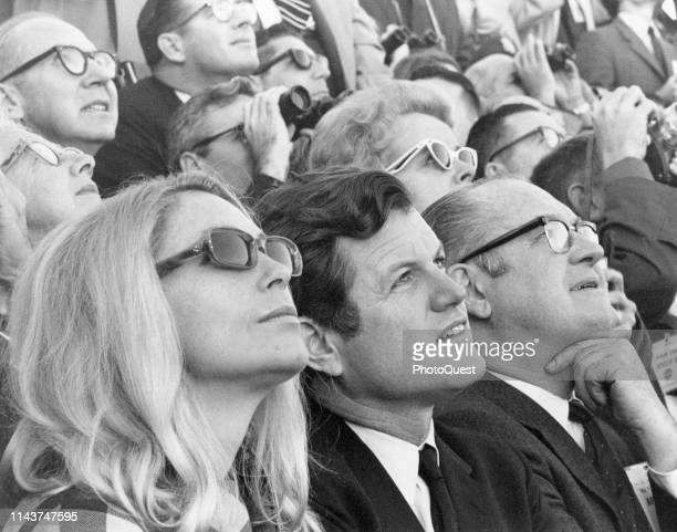 Close-up of married American couple Joan Kennedy and politician US Senator Edward Kennedy on a viewing stand near the Kennedy Space Center as they...