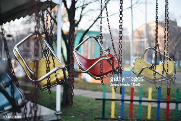 close-up of marry-go-round in playground - jelena ivkovic stock pictures, royalty-free photos & images