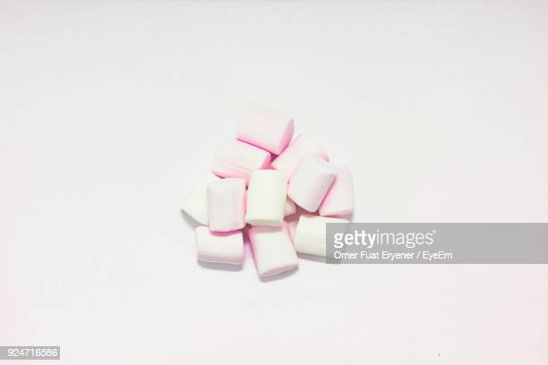 Close-Up Of Marshmallows Against White Background