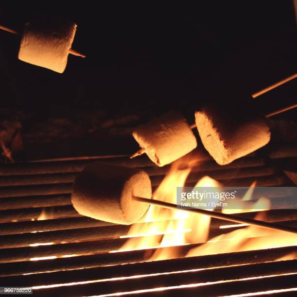 Close-Up Of Marshmallows Being Roasted Over Barbeque Grill