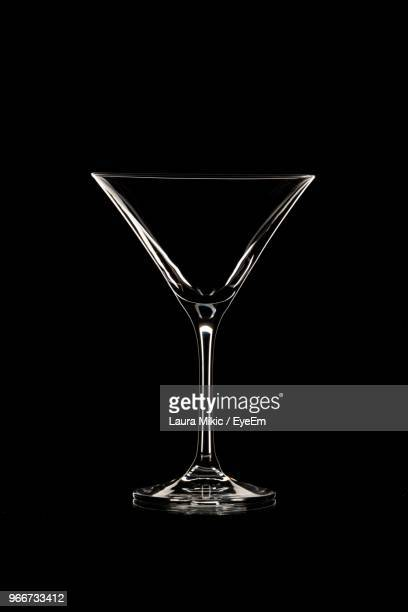 close-up of martini glass against black background - martini glass stock pictures, royalty-free photos & images