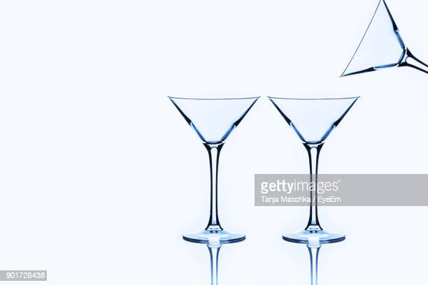 close-up of martini glasses against white background - martini glass stock pictures, royalty-free photos & images