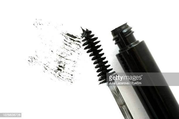 close-up of mascara against white background - mascara stock pictures, royalty-free photos & images
