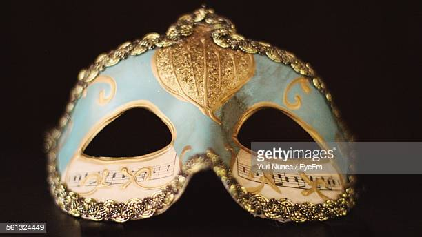 close-up of mask against black background - black mask disguise stock pictures, royalty-free photos & images