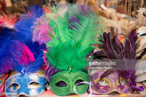 close-up of masks at market stall - venice carnival stock pictures, royalty-free photos & images