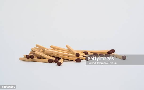 Close-Up Of Matches On White Background