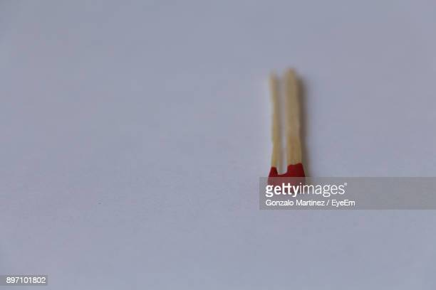 Close-Up Of Matchstick Over White Background