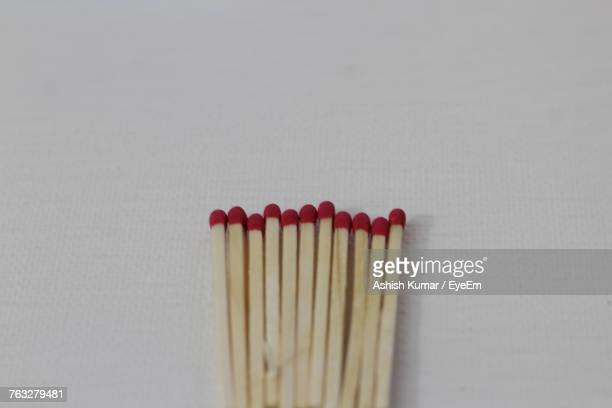 Close-Up Of Matchsticks On Table