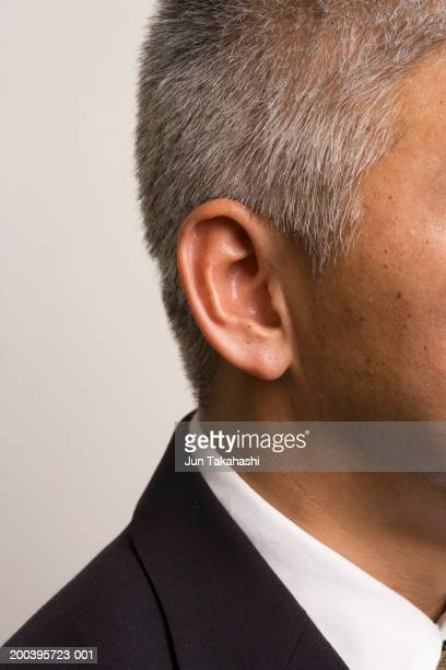 Close-up of mature businessman's ear and neck, side view