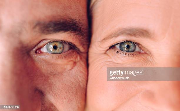 close-up of mature man and woman's faces with green eyes - eye stock pictures, royalty-free photos & images