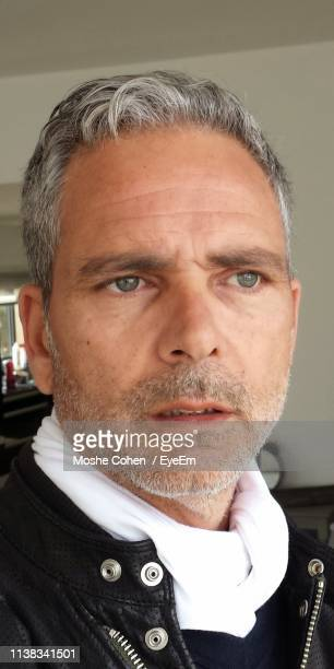 close-up of mature man looking away - gray eyes stock pictures, royalty-free photos & images