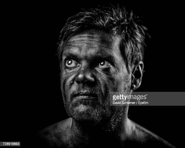 close-up of mature man with painted face against black background - body paint fotografías e imágenes de stock