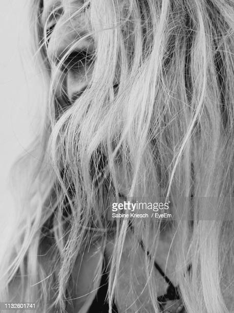 close-up of mature woman with long hair - sabine kriesch stock-fotos und bilder