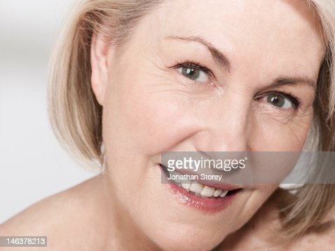 Closeup Of Mature Womans Face Stock Photo | Getty Images