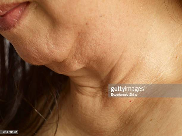 Close-up of mature woman's neck