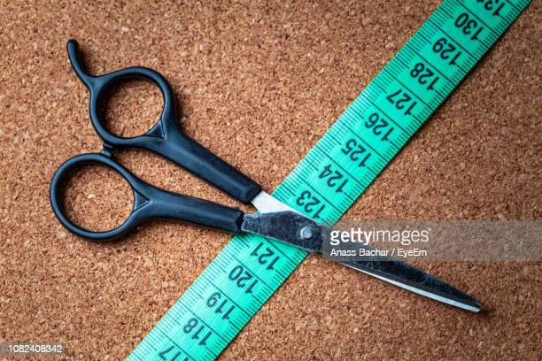 Close-Up Of Measuring Tape And Scissor