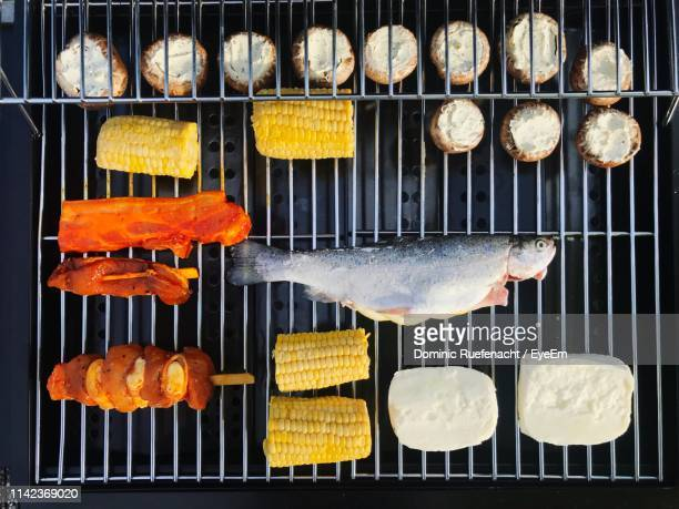 close-up of meat and vegetables on barbecue grill - metal grate stock photos and pictures