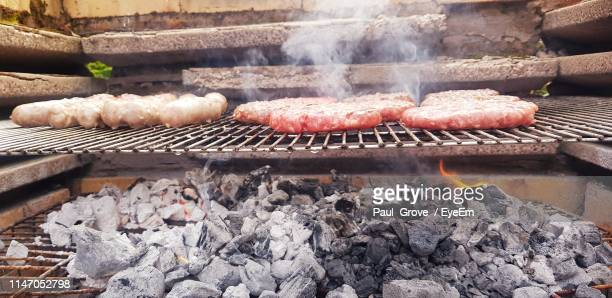 close-up of meat on barbecue grill - coal stock pictures, royalty-free photos & images