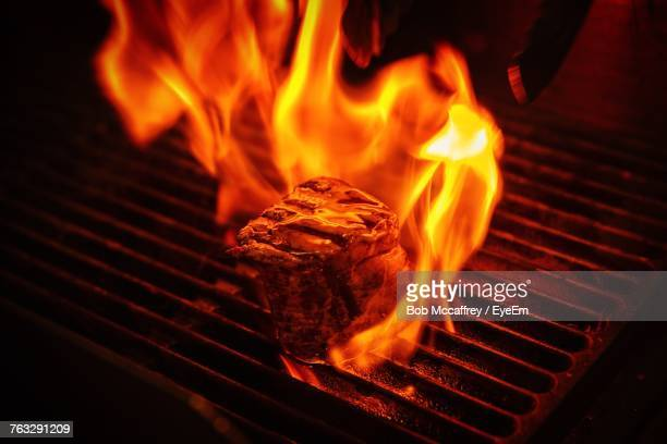 close-up of meat on barbecue grill - metal grate stock photos and pictures