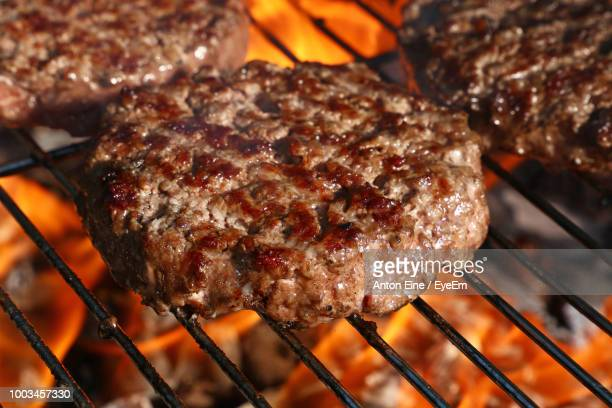 close-up of meat on barbecue - hamburger stock pictures, royalty-free photos & images