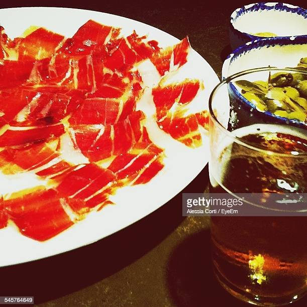 close-up of meat on plate with drink on table - extremadura fotografías e imágenes de stock