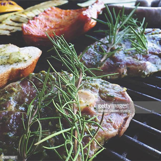 Close-Up Of Meat With Rosemary On Barbeque