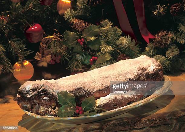 close-up of meatloaf kept beside Christmas decorations