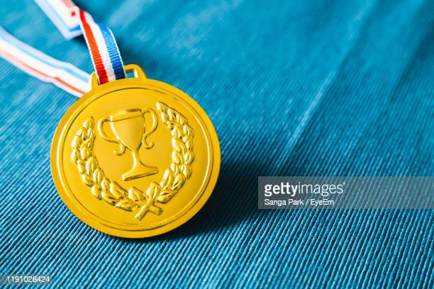 close-up of medal against blue background - hero and not superhero stock pictures, royalty-free photos & images