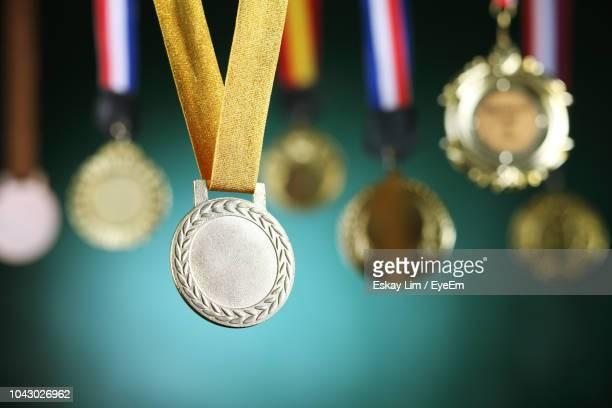 close-up of medals against blackboard - second place stock pictures, royalty-free photos & images