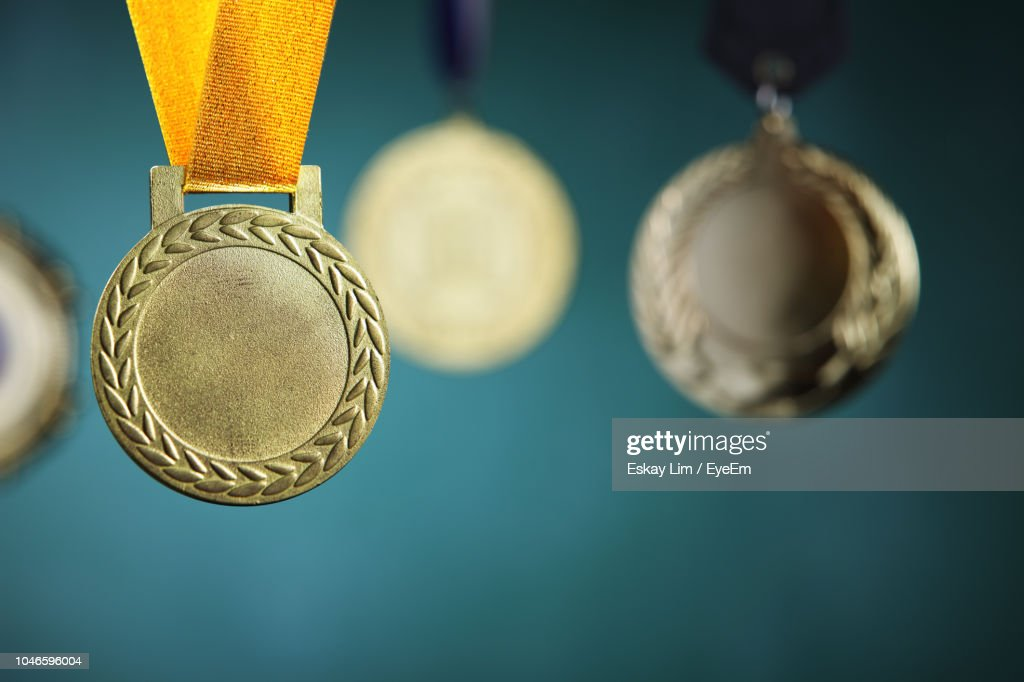 Close-Up Of Medals Hanging Against Blackboard : Stock-Foto