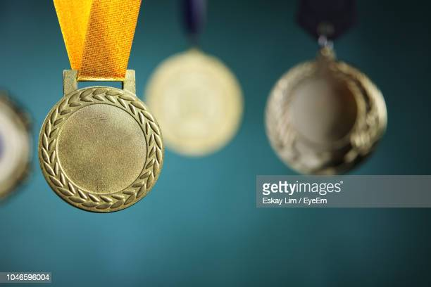 close-up of medals hanging against blackboard - gold medal stock pictures, royalty-free photos & images