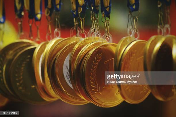 close-up of medals hanging - awards stock photos and pictures